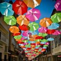 Colorful Floating Umbrella Installation At Agueda, Portugal